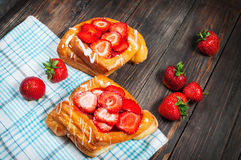 Dessert fruit cakes with strawberry on wood background Royalty Free Stock Images