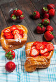 Dessert fruit cakes with strawberry on wood background Royalty Free Stock Image
