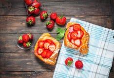Dessert fruit cakes with strawberry on wood background Stock Image
