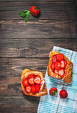 Dessert fruit cakes with strawberry on wood background Stock Photos