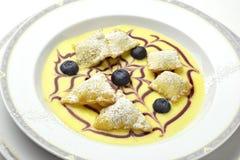 Dessert Fruit ravioli on English custard Stock Photos