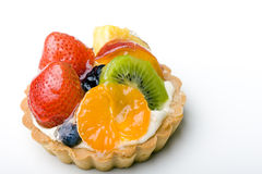 Dessert fruit tart pastry with whipped cream. Strawberry, kiwi, tangerine, pineapple delicious dessert fruit tart pastry with whipped cream layer stock images