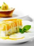 Dessert - gâteau au fromage orange images libres de droits