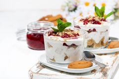 Dessert in a glass with biscuits, cream and jam Stock Photography