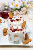 dessert in a glass with cookies, cream and berries jam, vertical Royalty Free Stock Photos