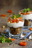 Dessert from granola,yogurt,nuts and dried apricot. Stock Photos