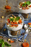 Dessert from granola,yogurt,nuts and dried apricot. Stock Image