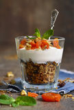 Dessert from granola,yogurt,nuts and dried apricot . Royalty Free Stock Photography