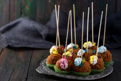 Dessert for Halloween. Sweets for Halloween. Lolipopes of an anthill cake with jelly frogs Stock Image