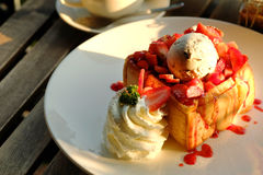 Dessert honey toast with ice cream and strawberry for romantic sweet time in valentine`s day Royalty Free Stock Image