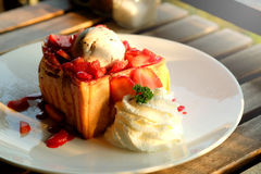 Dessert honey toast with ice cream and strawberry for romantic sweet time in valentine`s day Royalty Free Stock Images