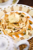 Dessert with ice-cream. Nuts and tea Royalty Free Stock Image