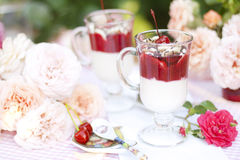 Dessert of ice-cream, bananas and cherries in a glass Stock Images