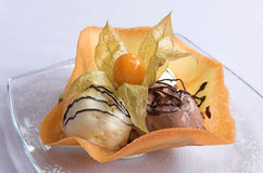 Dessert from ice-cream, chocolate and caramel. Dessert from three kinds of ice-cream Royalty Free Stock Photos
