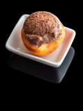 Dessert ice cream on peach. Black background with reflection Royalty Free Stock Images