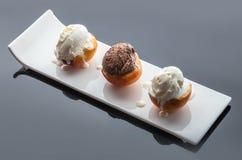 Dessert ice cream on peach. Dark background with reflection Stock Photo