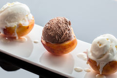 Dessert ice cream on peach. Dark background with reflection Stock Image