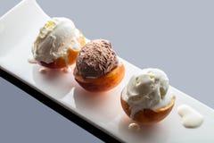 Dessert ice cream on peach. Dark background with reflection Royalty Free Stock Photos