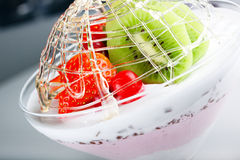 Dessert ice-cream with a strawberry and kiwi. Dessert from an ice-cream with a strawberry and kiwi Royalty Free Stock Photo