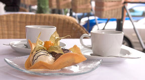 Dessert from ice-cream with tea. Dessert from ice-cream, chocolate and caramel Royalty Free Stock Photography