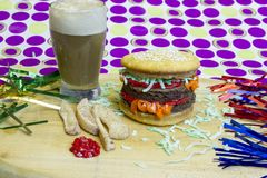 Dessert impostor cheeseburger with apple fries and root beer flo. Dessert impostor mock hamburger and cheeseburgers with vanilla cupcake bun and brownie burger Royalty Free Stock Photo
