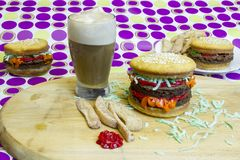 Dessert impostor hamburger and cheeseburgers with apple fries an Royalty Free Stock Images