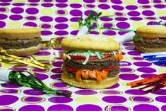 Dessert impostor hamburger and cheeseburgers with colorful strea Royalty Free Stock Photography