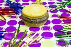Dessert impostor hamburger on polka dots Stock Photos