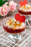 Dessert with jam and whipped cream for Valentine's Day, vertical Stock Photo