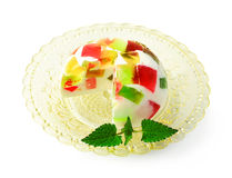 Dessert of jelly on a glass stand. Isolated on white stock image