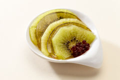 Dessert kiwi and red berries in jelly. A dessert of pieces of kiwi and red berries in jelly Stock Photography