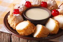 Dessert Leche frita with condensed milk and cherries closeup. ho. Dessert Leche frita with condensed milk and cherries on a plate closeup. horizontal royalty free stock images