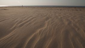 Dessert like textured sand - Baltic sea gulf beach with white sand in the sunset - 4K video with slow camera movement stock video footage