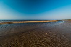 Dessert like textured sand - Baltic sea gulf beach with white sand in the sunset royalty free stock photo