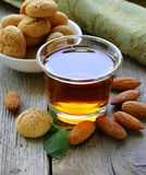 Dessert liqueur Amaretto with almond biscuits (amarittini) Royalty Free Stock Photo