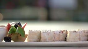 Dessert on long plate. stock video