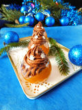 Dessert made of mandarins and chocolate. Dessert made of mandarin jelly and chocolate mousse surrounded by Christmas decorations stock images
