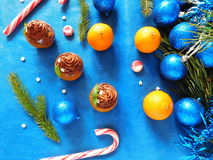 Dessert made of mandarins and chocolate. Dessert made of mandarin jelly and chocolate mousse surrounded by Christmas decorations royalty free stock photo