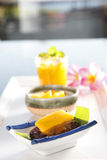 Dessert with mango flavor. On the dish Stock Photography