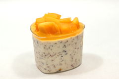 Dessert with mango mousse in cup. Royalty Free Stock Image