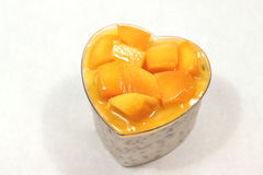 Dessert with mango mousse in cup. Stock Image