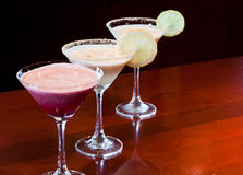 Dessert Martinis. Three dessert martinis lined up on a bar top decorated and ready to drink Royalty Free Stock Photography
