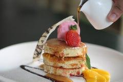 Dessert menu promo on jakarta indonesia ba bi bu la. Winter pancake with honey, strawberry, orange, chocolate Stock Photography
