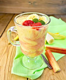Dessert milk with rhubarb and banana on board Royalty Free Stock Images