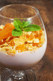 Dessert with muesli , yogurt and dried apricots in a glass Royalty Free Stock Image