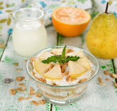 Dessert of muesli and yogurt with pear Royalty Free Stock Photo