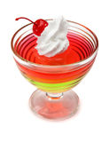 Dessert multicolore de gelée avec de la crème et la cerise fouettées Image libre de droits