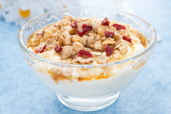 Dessert of natural yogurt with maple syrup, granola and nuts Stock Photos