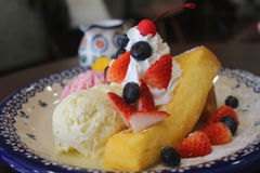 Dessert on nice holiday. Honey toast with ice cream vanilla, strawberry and blue berry Royalty Free Stock Image