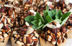 Dessert with nuts and mint. Stock Image